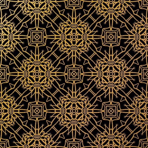 Бесшовный узор из роскошного золотого батика, индонезийский батик - это техника воскорезистового окрашивания, наносимая на всю ткань Premium векторы
