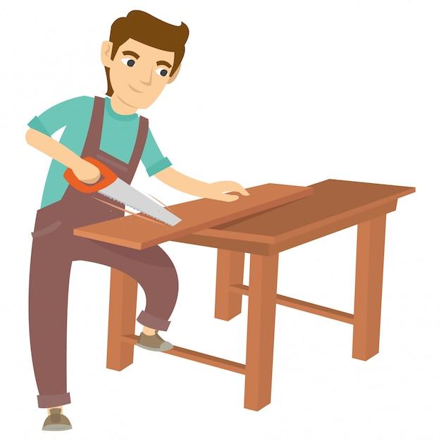 木材をテーブルの上で鋸で削る大工 Premiumベクター