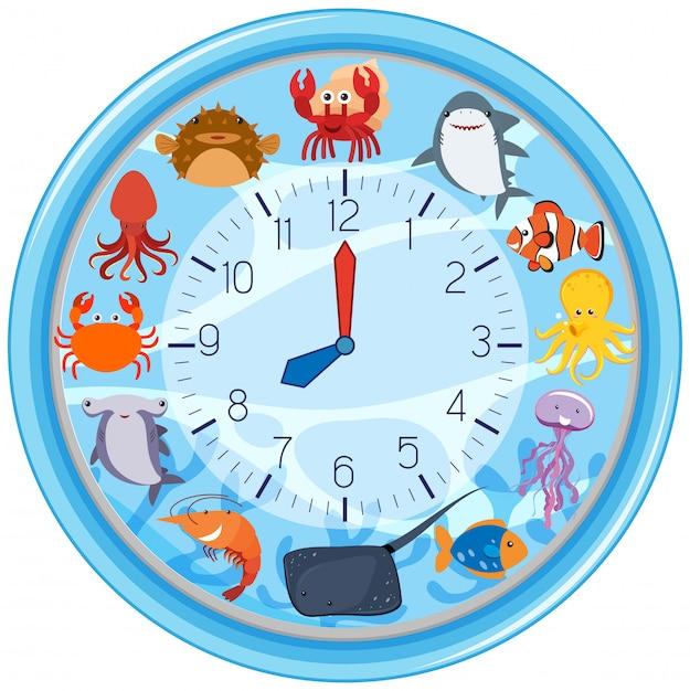 海の生き物のテンプレートと時計 無料ベクター