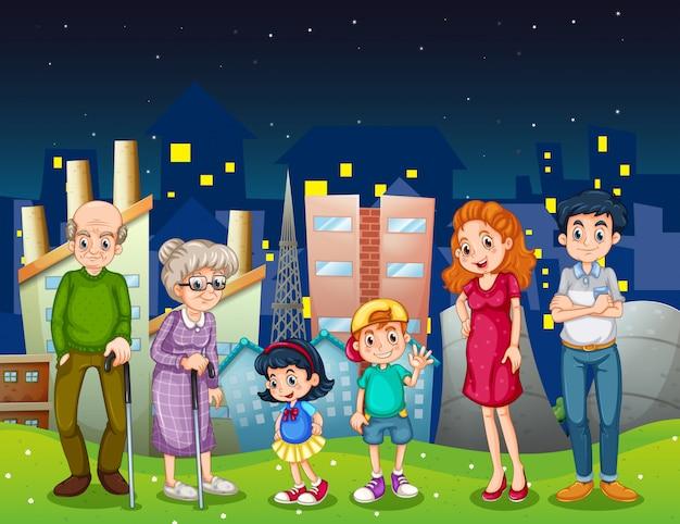 Семья в городе, стоящая перед высокими зданиями Бесплатные векторы