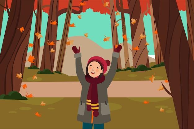 少女は秋の葉の滝を見て幸せ Premiumベクター
