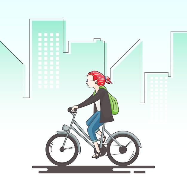 女の子は自転車の概念図に乗っています。 Premiumベクター