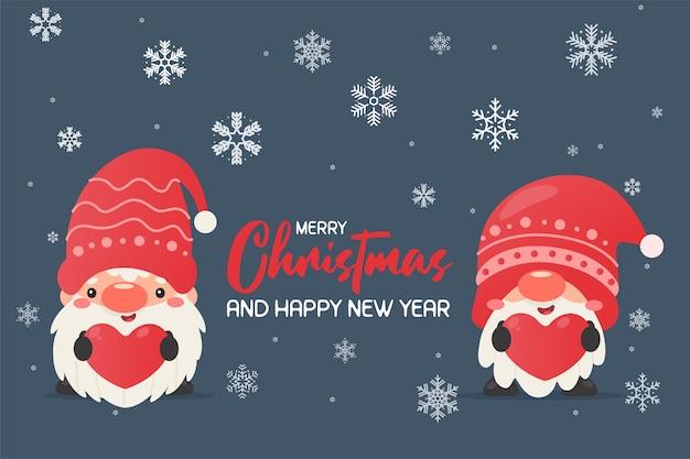 クリスマスの帽子をかぶったノーム赤いハートのラベルを持ってクリスマスに雪の冬 Premiumベクター