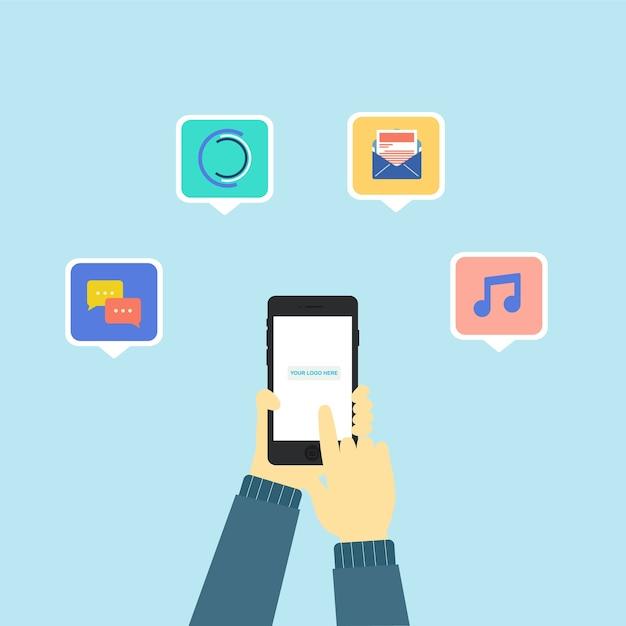 いくつかのアプリのアイコンが付いている電話を持っている手 Premiumベクター