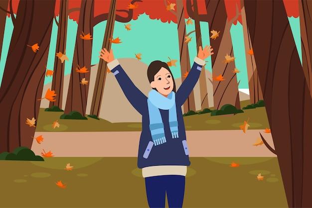幸せな女性は、公園で自然な秋のシーズンを愛する Premiumベクター