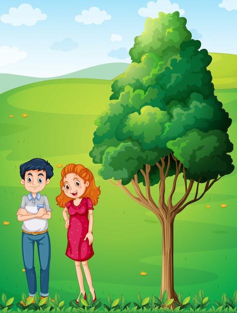 丘の上の大きな木の近くに母親と父親 無料ベクター
