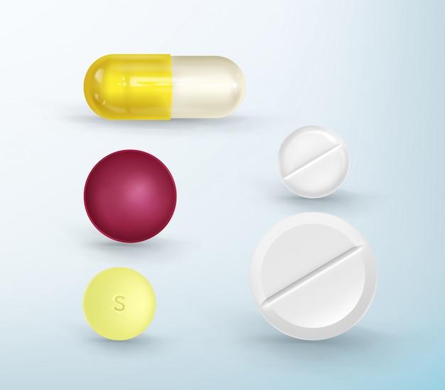 Набор разноцветных таблеток различной формы. Premium векторы
