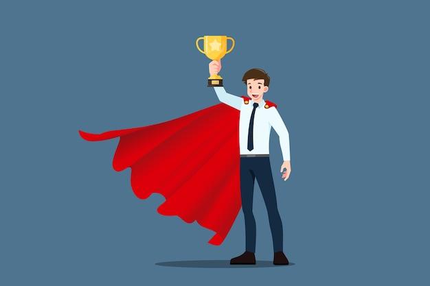 성공적인 젊은 사업가 착용 빨간 케이프 인상 & 금 트로피 컵을 들고. 프리미엄 벡터