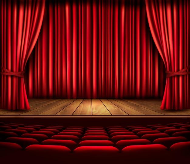 Сцена театра с красным занавесом, сиденьями и прожектором. Premium векторы