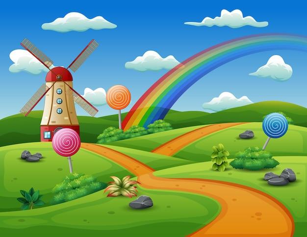 풍차와 자연 배경에 사탕 프리미엄 벡터