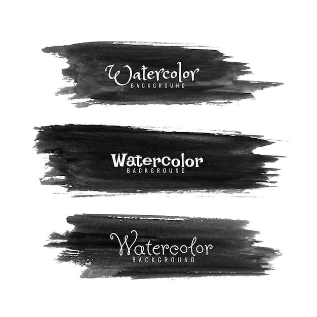 Set di tratti di acquerello nero astratto Vettore gratuito
