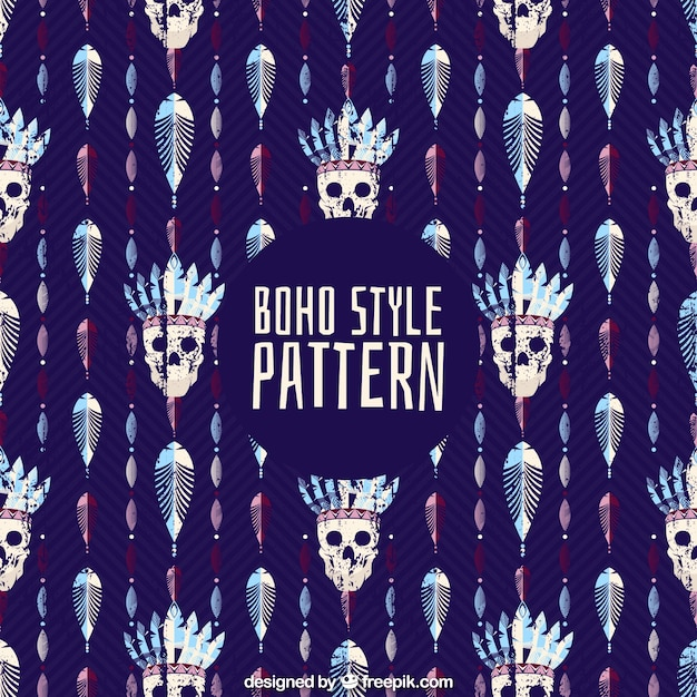 Abstract boho pattern with skulls and feathers Free Vector