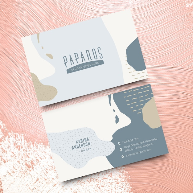 Abstract business card template with pastel-colored stains Free Vector