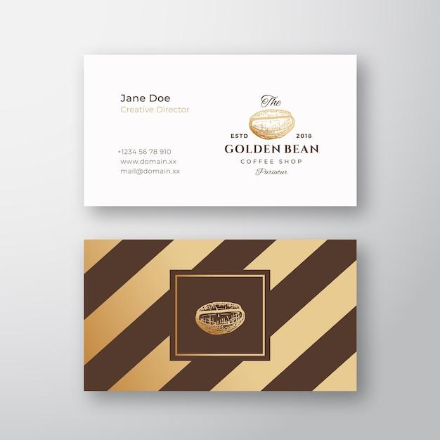 抽象的なエレガントなコーヒーのロゴと名刺テンプレート。手描きの黄金のコーヒー豆。 Premiumベクター