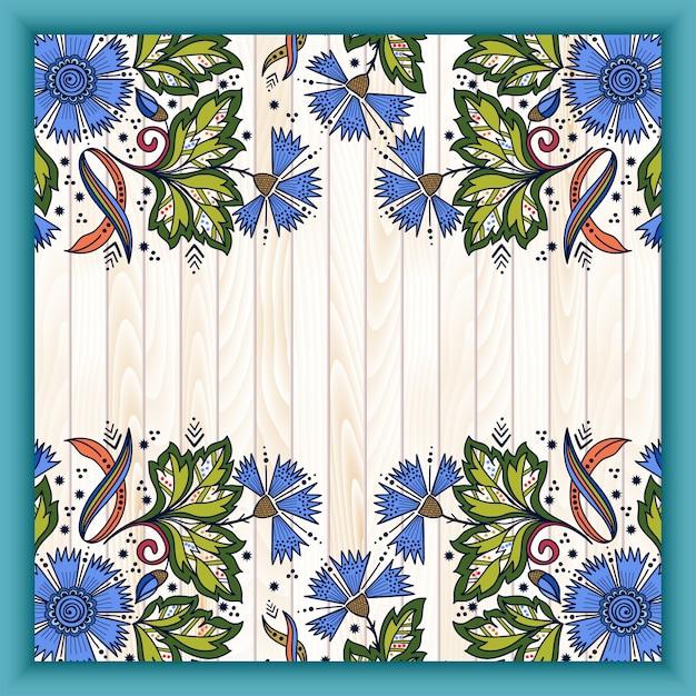 木製の背景にインドの一時的な刺青スタイルで抽象的な花の要素。 無料ベクター