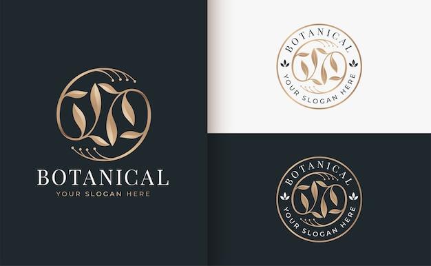 抽象的な黄金の花ラインアートのロゴ Premiumベクター
