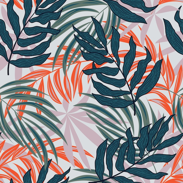 Abstract seamless pattern with colorful tropical leaves and plants on white background Premium Vector