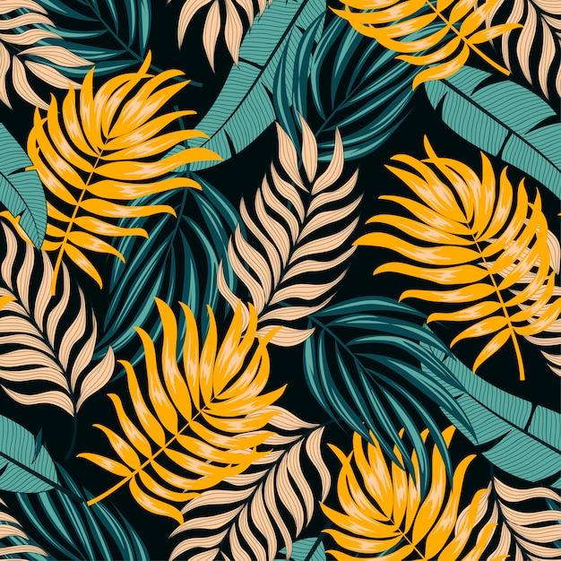 Абстрактный бесшовные тропический узор с яркими листьями и растениями на темном фоне Premium векторы