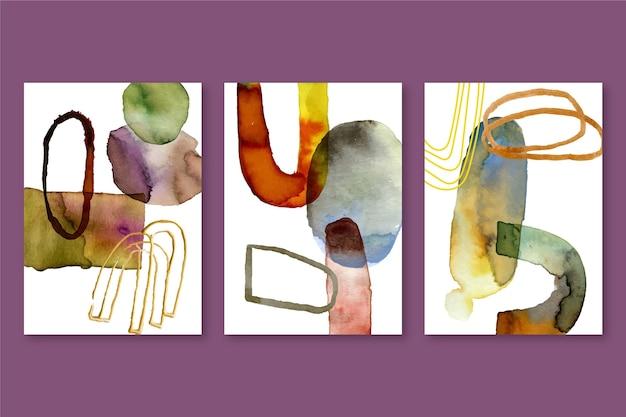 異なる形状の抽象的な水彩画カバーセット 無料ベクター