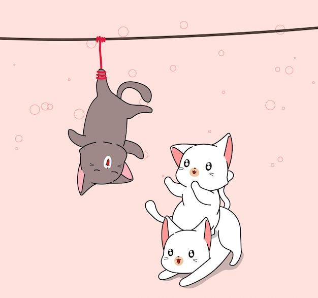 Очаровательные 2 белых кота играют с черным котом, которого повесили Premium векторы