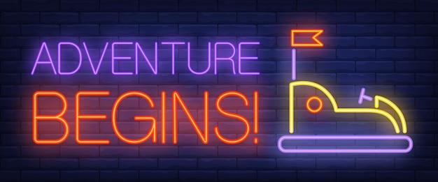 Adventure begins neon text with bumper car Free Vector