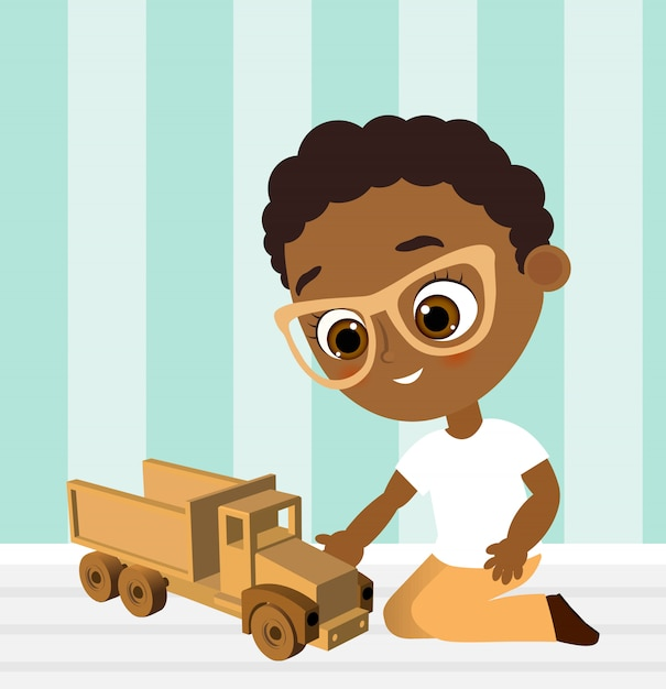 African american boy with glasses and toy car. boy playing car. Premium Vector