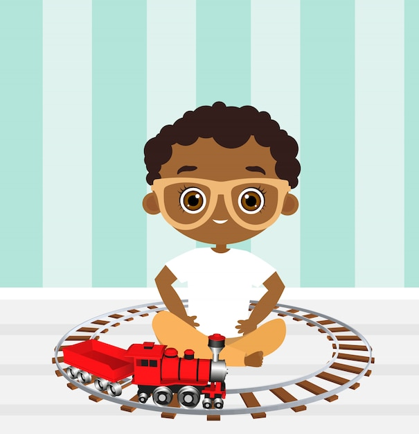 African american boy with glasses and toy train. boy playing with train Premium Vector