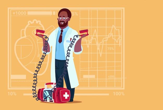 African american doctor hold defibrillator medical clinics worker reanimation hospital Premium Vector