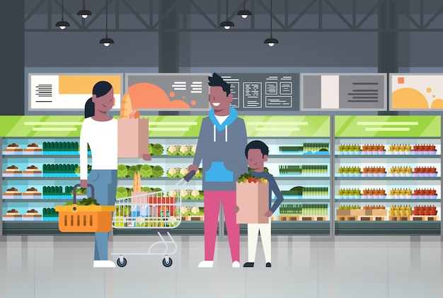 African american family shopping at supermarket and buying products Premium Vector