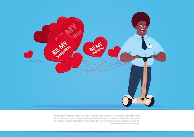 African american man with heart shaped air balloons riding electric scooter happy valentine day concept Premium Vector