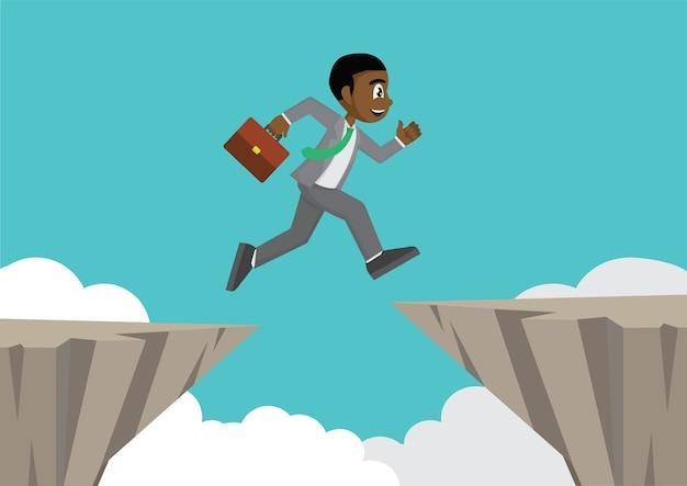 African businessman jump over cliff gap. Premium Vector