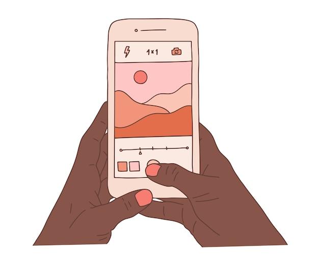 スマートフォンを持ってアフリカの人間の手と美しい自然の風景写真を撮ります。風景写真撮影フラットカラフルな漫画イラスト。 Premiumベクター