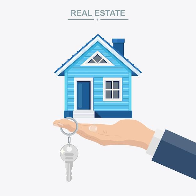 Агент держит дом и ключ в руке. ипотека, сделка с недвижимостью, аренда имущества Premium векторы