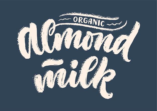 Надпись миндального молока для логотипа баннера и дизайна упаковки Premium векторы