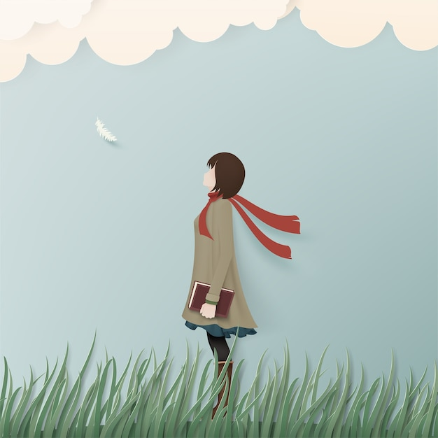 Alone girl in winter coat on green grass with book. Premium Vector