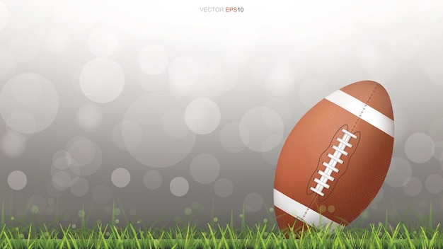 American football ball or rugby ball on grass field. Premium Vector