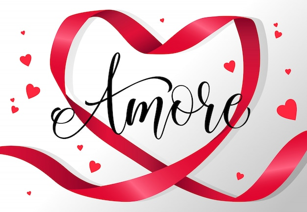 Amore lettering in red heart shaped ribbon frame Free Vector