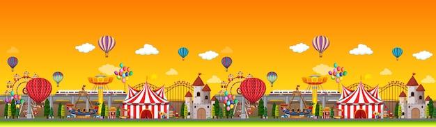 気球のパノラマと昼間の遊園地のシーン 無料ベクター