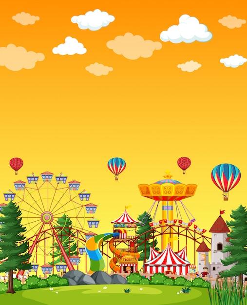 Сцена парка развлечений в дневное время с пустым желтым небом Бесплатные векторы