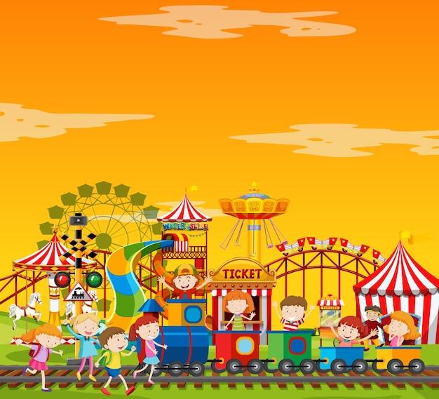 Сцена в парке развлечений в дневное время с пустым желтым небом Бесплатные векторы