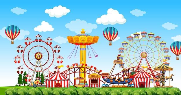 Scena del parco di divertimenti durante il giorno con palloncini nel cielo Vettore gratuito