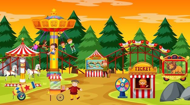 Scena del parco di divertimenti durante il giorno con il cielo giallo Vettore gratuito