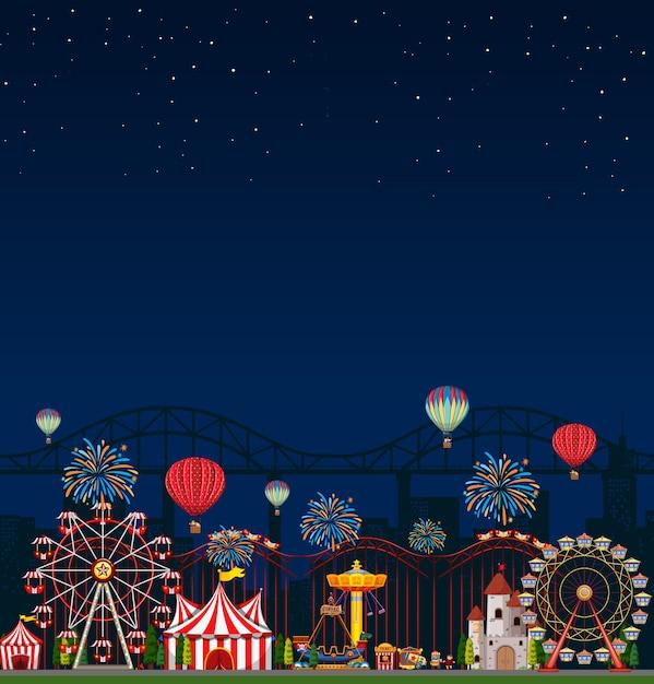 Amusement park scene at night with blank dark blue sky Free Vector