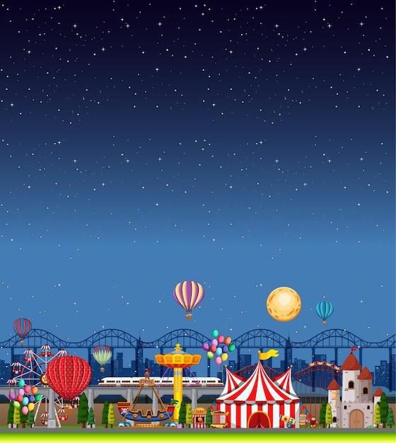 Scena del parco di divertimenti di notte con cielo blu scuro vuoto Vettore gratuito