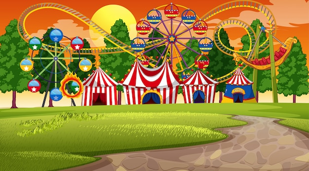 Amusement park sunset scene or background Free Vector