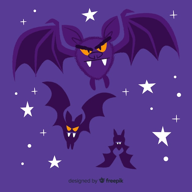 Angry bats flying in the night Free Vector