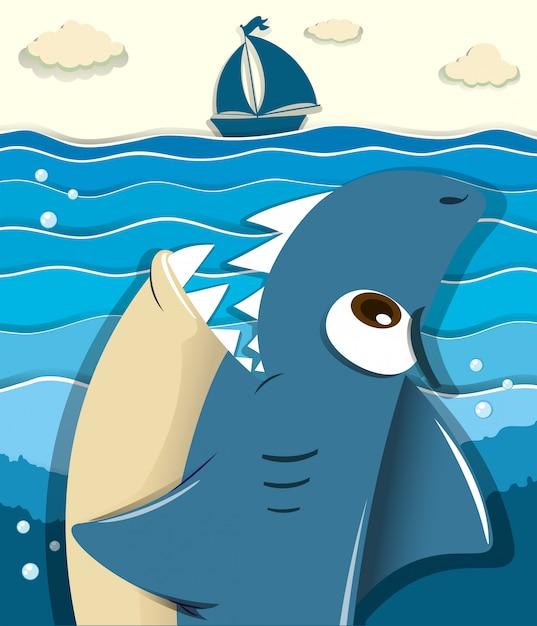 Squalo arrabbiato che mira alla barca a vela Vettore gratuito