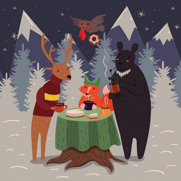 冬の森のアニマルティーパーティー Premiumベクター