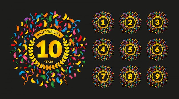 Anniversary badges set with colorful confetti Premium Vector