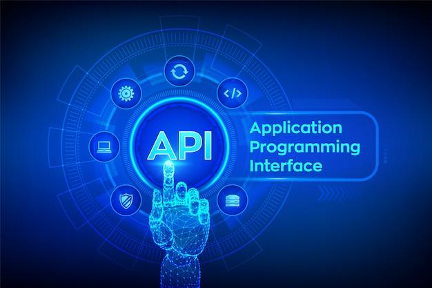 Api。アプリケーションプログラミングインターフェイス。デジタルインターフェイスに触れるロボットの手。 Premiumベクター